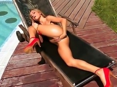 Hardcore action as beautiful brunette Leyla Black lies down naked outside, and begins to play with her shaven pussy. Watch as she manages to twist her body enough to be able to give herself a really good fisting session.