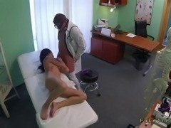 Tattooed brunette amateur girl came to doctor because she has chest pain and soon he strips her off and fucks her pussy on examining table in fake hospital