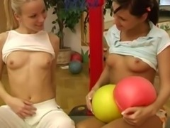 Lesbian teen girls Cindy and Amber toying snatches in the gym