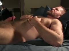 Bear strokes his cock