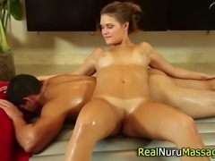 Slutty masseuse sucking cock and fucking during nuru massage