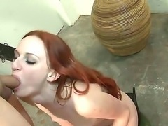 Young looking playful redhead babe Audrey Lords with soft milky skin and slim fit body in underwear and leather boots teases tied up asian dude and takes on his cock.
