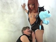 This buff black shemale has her cock sucked by a pathetic white subbie, and...