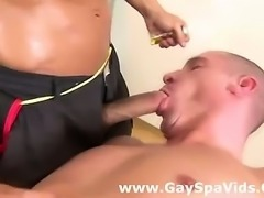 Two muscled gay guys suck cock at spa