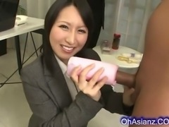 Pertty asian business woman makes a hard swollen cock cum hard in her soft oiled hands