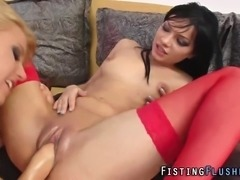Stockings clad pussy fisted lesbian squirts for fetish babe