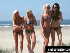 Awesome lesbian teen sirens lick and finger  their petite shaved pussies on the beach