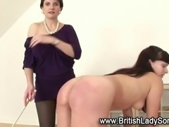 Mature femdom babe spanks fetish slut in stockings