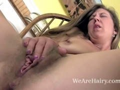Valentine enjoys wine and looking beautiful. In her floral dress she looks very nice. The dress comes off and so does her purple panties. Then, she spreads her legs to reveal her beautiful hairy pussy.