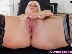 Solo blonde masturbating her vulva with her dildo