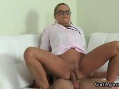 Blonde female agent with glasses interviews hot amateur dude then sucks his dick on couch and gets her pussy licked and fucked by him