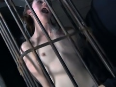 BDSM sub caged and dunked underwater