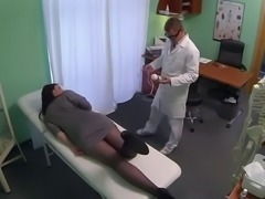 Babe plays with massage tool in fake hospital