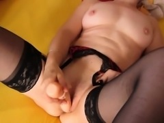 Mature Woman Masturbating With A Toy