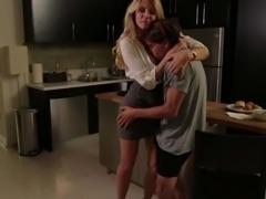 Incredibly beautiful MILF Jessica Drake in short skirt and blouse seduces a boy in the kitchen and gives blow job he will never forget. She sucks his dick with her nice milf ass up