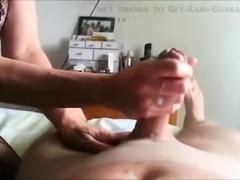 Experienced MILF gives him a handjob