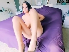 Raven haired slut is in a pov video. She has her huge ass turned to us. A large cock is going inside her ass and cunt in this scene. It is clear that she is enjoying it.