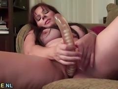 """Mature amateur dildo fucks her wet pussy"""