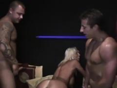 Busty blonde hooker pleasures two hard dicks