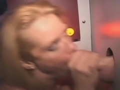 Blonde Housewife Taking Facial Through A Glory Hole
