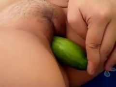 Filipina playing cucumber