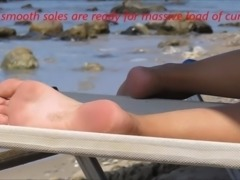 Young lady's footplay on the beach