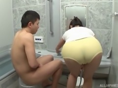 Fine ass Japanese milf blows him in the bathroom
