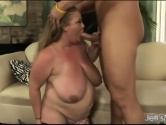 Voluptuous milf in fishnet stockings rides a hard pole with intensity
