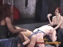 Nasty mistresses play with their slaves together in dungeon