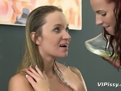 Red haired slut fucks pee fetish chick with red dildo