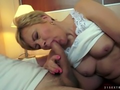 Dirty and cock hungry granny gives head in her bedroom