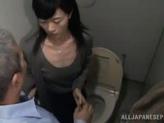 Mature Japanese pornstar getting fucked doggy style by a horny old guy in the toilet