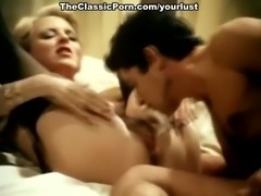 Insatiable Aunt Pegs fucks John Holmes in a missionary position in exciting retro porn clip