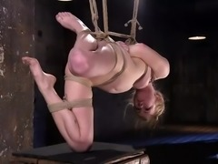 This is the horny blonde's first BDSM session and she totally liked it. It was painful at first and she cried a lot. But when the master placed an electric vibrator on clit, her painful screams turned into pleasurable moans and even in that tied up position also, her pussy leaked lot of juices.