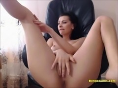Lovely amateur brunette fingering her cunt