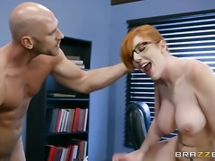 Johnny Sins is one hard-dicked guy who loves oral sex with Redhead with massive boobs