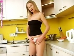 Kinky blonde Adelina loves masturbating in a kitchen