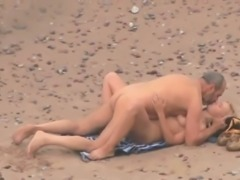Mature grey haired chubby dude was fucking his blonde wife on the beach
