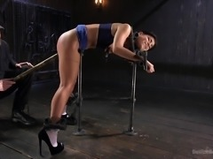The slave bent over in the bondage device and her master shoved that big dildo on a pole, as far up her pussy as he could possibly get it. She took it like a champ, but what choice did he really have, when she is locked up like that?