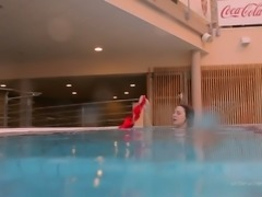 Adorable and fresh white babe in red bikini dives in the pool
