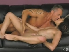Raven-haired babe Eden Sinclair and her tiny tits take a wild ride on a black couch with muscled hunk Marcus London. Sexy in her specs, she shows off her gorgeous tattoo, while engaging in a hot sixty-nine. Marcus then introduces his thick cock to her wet mouth and tight ass.