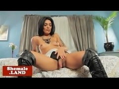 Stunning tgirl beauty playing with her cock