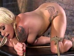 Blonde in ropes gets huge dildo