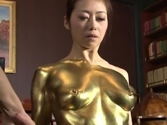 She is getting gold paint all over his crotch, as she rubs her face against it. This sexy Gold babe is here to worship her man's dick and fulfill his fanatsty of fucking a babe as beautiful, as a bar of gold.