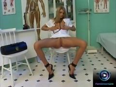 Foxy nurse rubbing her doctor's stethoscope