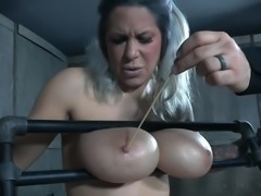 Alyssa Lynn was bounded and her huge tits protruded out of the metal bondage. The dominant stud was happy with his work and started the BDSM session by torturing her erect nipples. He whipped her boobs, feet, pussy and all other sensitive organs and the busty blonde cried in pain.