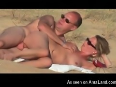Amateur nudists fuck dirty on a beach in sideways position