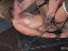 While her master's fat cock is sliding deeper inside her mouth, filling throat to the max, she can't help but cum. This sweet sub is getting spitroasted, locked on the dungeon desk. While she abandons herself to pleasure, a big dick fucks her mouth, while another one is plowing her cunt