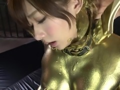 Japanese chick covered in gold has a blast riding a big boner