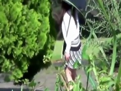 Asian pees in public park